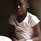 Haitian Girl in Doorway by Kent Nickell