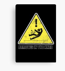 CAUTION - Arrows in the knee Canvas Print