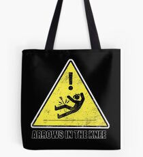 CAUTION - Arrows in the knee Tote Bag
