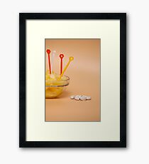 cup filled with pineapple slices handful of pills Framed Print