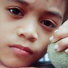 Boy Holding An Old Tennis Ball by Teody Gaspar