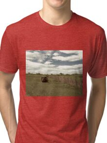 Old boat abandoned on a field Tri-blend T-Shirt