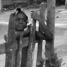Haitian Girl at the Gate to her Yard by Kent Nickell
