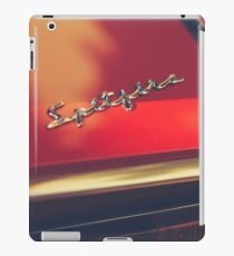 Macro photo of a Triumph Spitfire chromed logo, british red supercar, old classic auto iPad Case/Skin