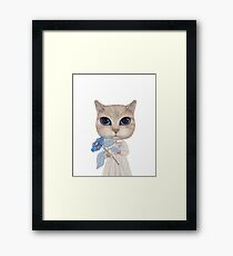 a cat with a blue flower on white Framed Print