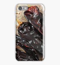 Large, dried poblano peppers on a rustic background iPhone Case/Skin