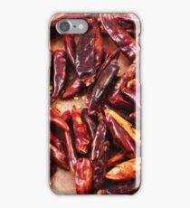 Dried red chilis on a rustic background iPhone Case/Skin