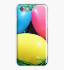 Three colored eggs surrounded by easter grass iPhone Case/Skin