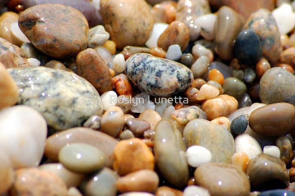 ocean pebbles by Roslyn Lunetta