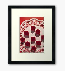 Red marmalade in molds on white napkin Framed Print