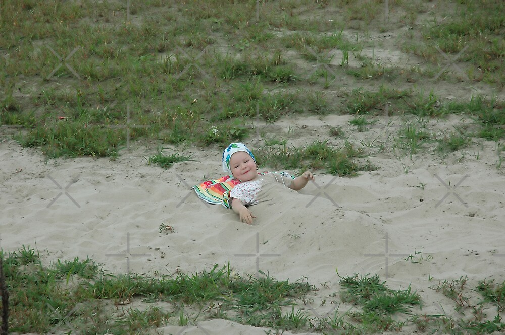 Girl playing in the sand by queensoft