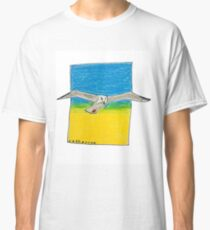Soaring seagull in a clear sky Classic T-Shirt