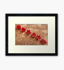 Red marmalade in molds on wooden background Framed Print