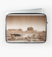 Vintage, artistic concept showing the old image of the unique natural structures in Monument Valley. Laptop Sleeve