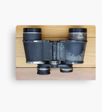 Old military binoculars on table Canvas Print