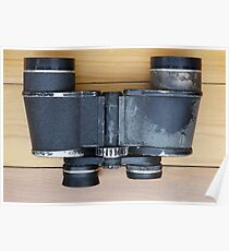 Old military binoculars on table Poster