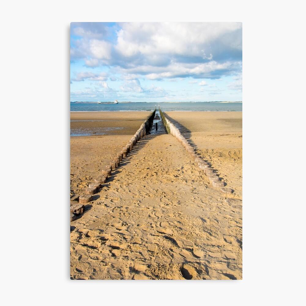 Breakwaters on the beach Metal Print