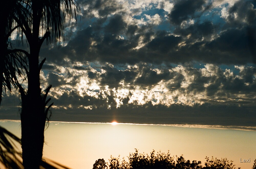 Blue Gray Cloud Sunset Over The Ocean by Lexi