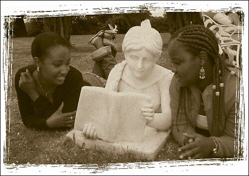 Reading with a Statue by Rebs O