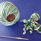 A green crochet octopus by Arianey