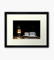 Cups of hot coffee and scattered grains of coffee on the table and kerosine lamp Framed Print