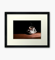 White cup of hot coffee on the table and a deep dark background Framed Print