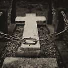 cross at graveyard by Nicole W.