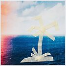 Taped Palm Tree on Printed Photo of Ocean by visualspectrum