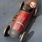Toy monkey in toy car by Flo Smith