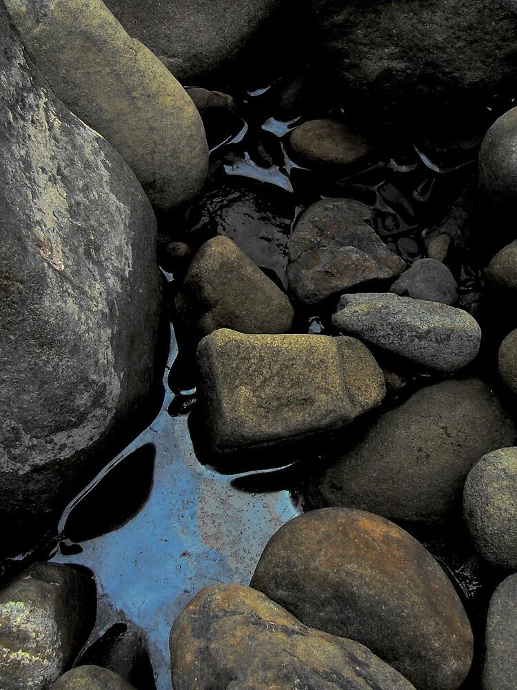 River rocks by Owen Kaluza