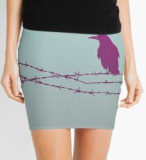Bird on barbed wire in pastel Mini Skirt