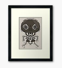 skull head and bone graffiti drawing with brown background Framed Print