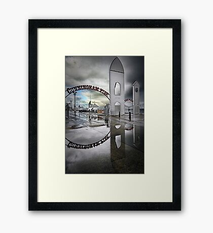 Stormy Day at the Pier Framed Print