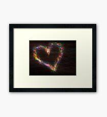 Abstract rainbow heart on black background.  Framed Print