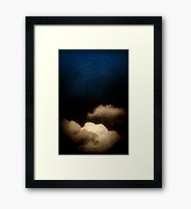 Clouds in a scratched darkness Framed Print