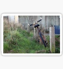 Abandoned  in overgrowing  grass Sticker