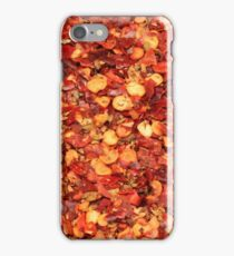 Ground red chili flakes and seeds close up iPhone Case/Skin