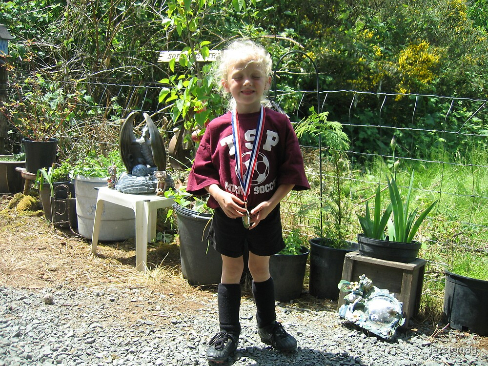Proud holder of a well earned soccer medal WHAT A FEELING by jazziemay