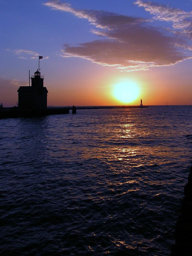 Holland Harbor Lighthouse Sunset by Brion Marcum