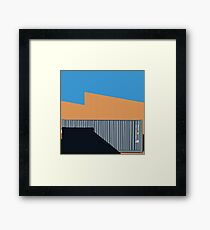 066 Gray shipping container warehouse blue sky Framed Print