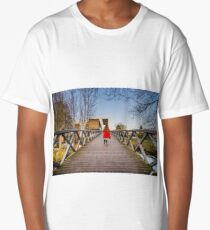 Little girl skating on the long wooden bridge over the river, symmetrical and perspective view Long T-Shirt