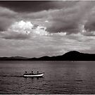 White Rowboat Under Stormy Sky by Wayne King