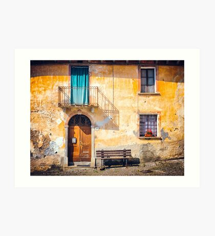 Old Italian facade with shadow and geraniums Art Print