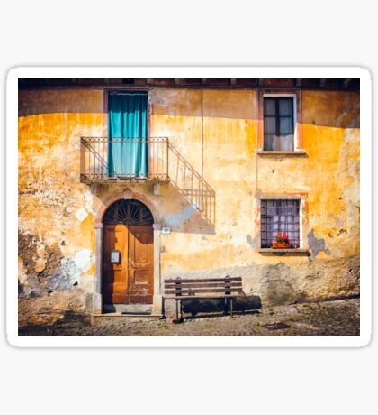 Old Italian facade with shadow and geraniums Sticker