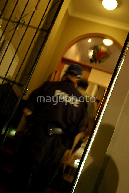 The man and the Police officer went inside for the investigation.. by mayuphoto
