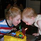 Blowing out the candles by Susan Moss