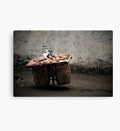 A bike load of potatoes Canvas Print