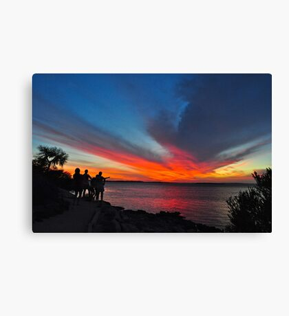 Watching the sun set Canvas Print