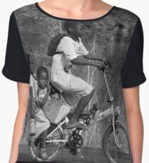 2 girls on the back a bicycle, coming from school, in Ghana, West Africa Chiffon Top