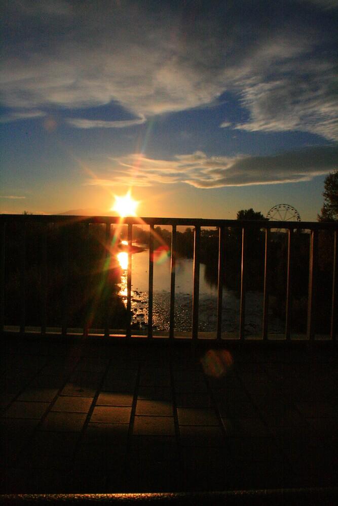 sunset from a bridge by jasonjerbil